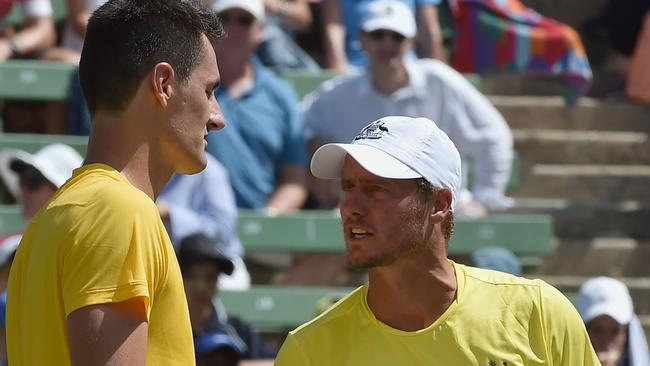 Bernard Tomic and Australia's team captain Lleyton Hewitt at the World Group first round Davis Cup tennis tournament at Kooyong in Melbourne in 2016. Hewitt last month said Tomic would never again feature in Davis Cup while he captained the Australian team. Picture: AFP