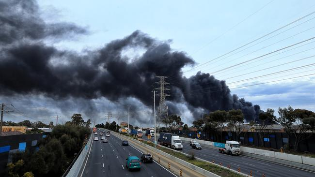 Smoke spreads across major roads and suburbs. Picture: Mark Stewart