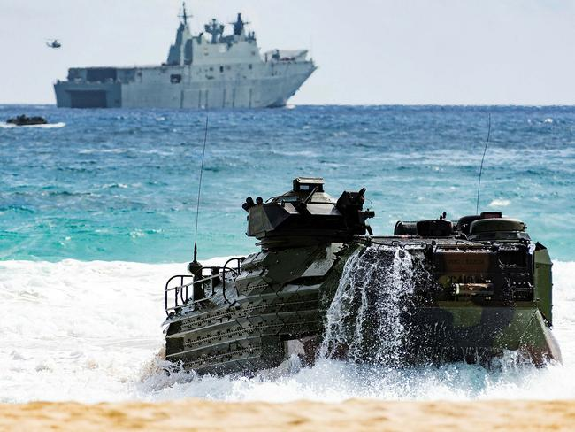 A United States Marine Corps Amphibious Assault Vehicle hits the beach at Kaneohe Bay after disembarking HMAS Adelaide during the final amphibious assault for Exercise RIMPAC 2018. Piture: Defence