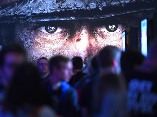 "Visitors wait at the stand of Call of Duty during the gaming fair ""gamescom"" in Cologne, Germany in Augustr. Picture: Patrik Stollarz"
