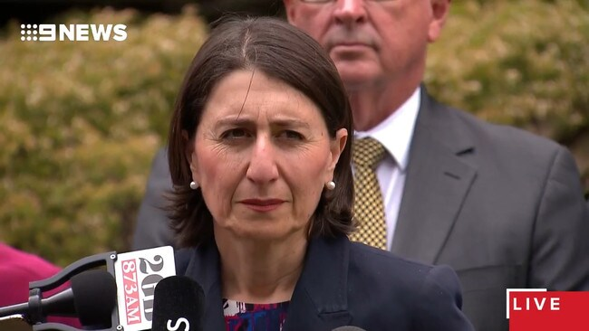 Gladys Berejiklian reacts as an independent journalist grills her at a press conference.