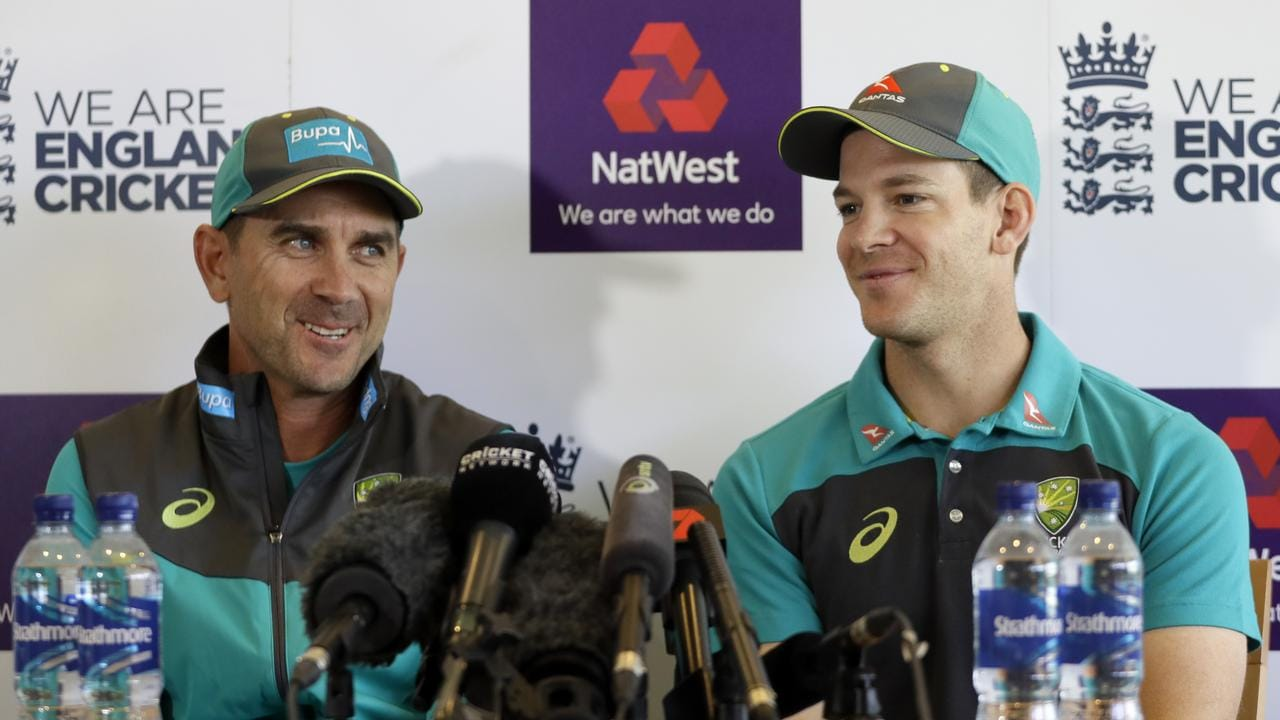 Australia cricket team head coach Justin Langer, left, and captain Tim Paine smile during a press conference at Lord's Cricket Ground.