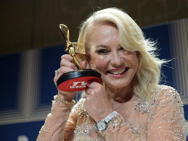 Kerri-Anne Kennerley poses for photographs with her Gold Logie for the TV Week Logie Hall of Fame. Picture: AAP