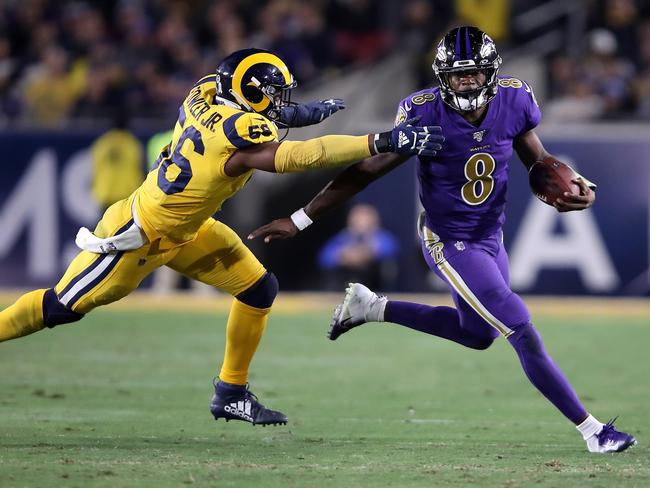 Dante Fowler Jr. of the Los Angeles Rams chases Lamar Jackson of the Baltimore Ravens. Picture: Getty Images