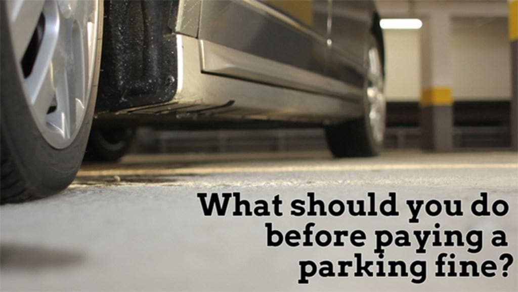 What should you do before paying a parking fine?