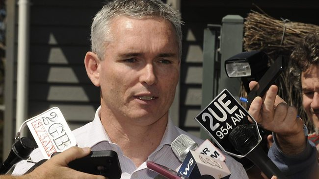 MP Craig Thomson faces the media after police seized documents from his Bateau Bay home . Picture: Peter Clark