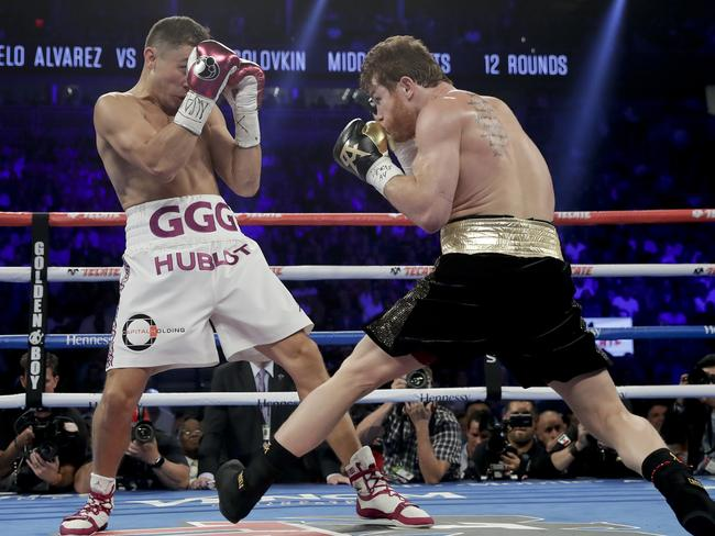 Gennady Golovkin covers up as Canelo Alvarez looks to move in. (AP Photo/Isaac Brekken)