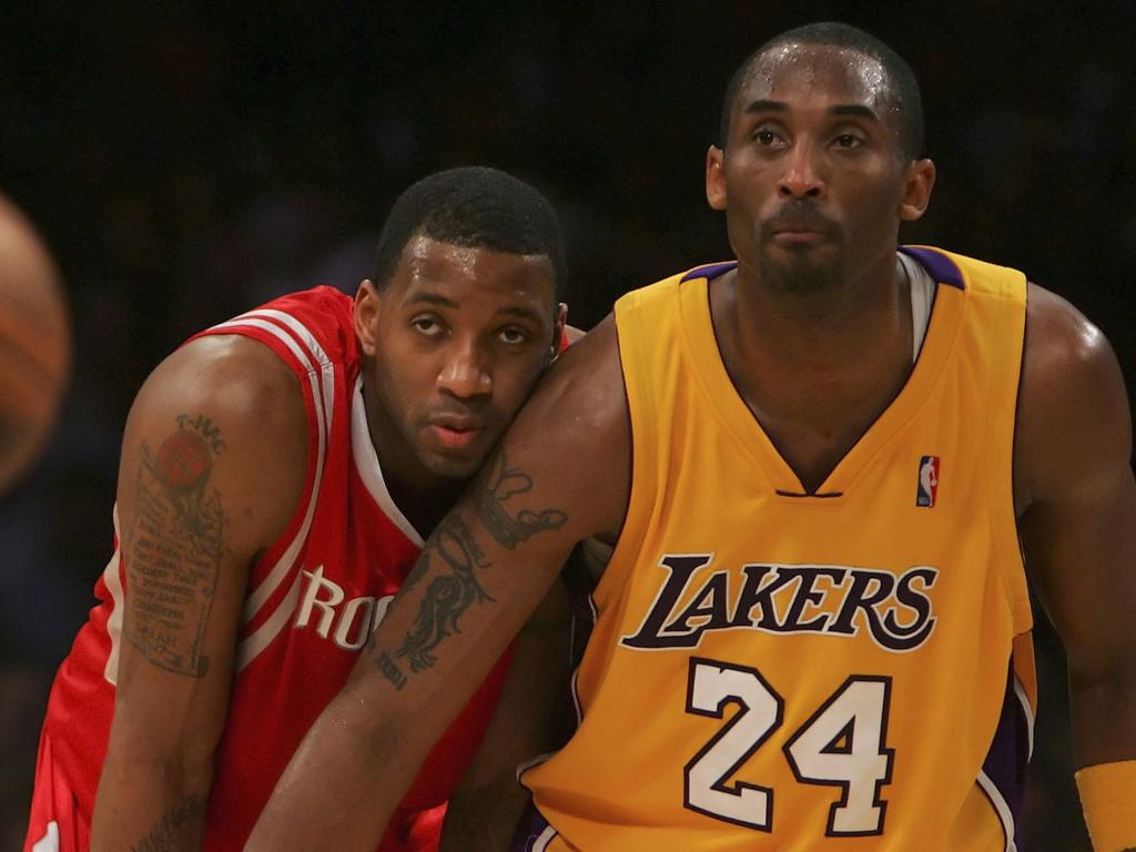 Kobe Bryant and Tracy McGrady on the floor together.
