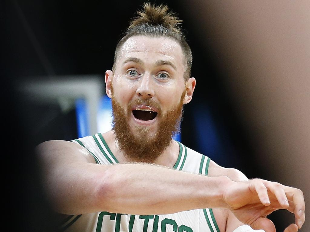 Boston Celtics' Aron Baynes talks with a referee during the second quarter of the team's NBA basketball game against the Memphis Grizzlies on Friday, Jan. 18, 2019, in Boston. (AP Photo/Winslow Townson)