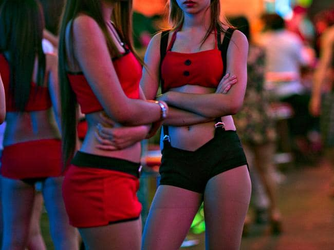 Thai women working at a bar wait for business at the Soi Cowboy red-light district in Bangkok. Picture: Paula Bronstein/Getty Images
