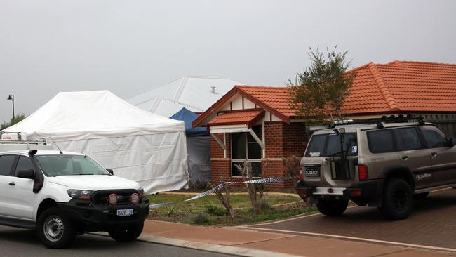 Forensic Services attend the scene where three people were found dead in Ellenbrook, Perth, Sunday, July 15, 2018. Picture: AAP/Trevor Collens.