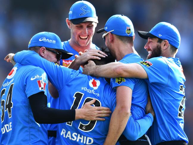 Rashid Khan's teammates celebrate his rare feat at Adelaide Oval.