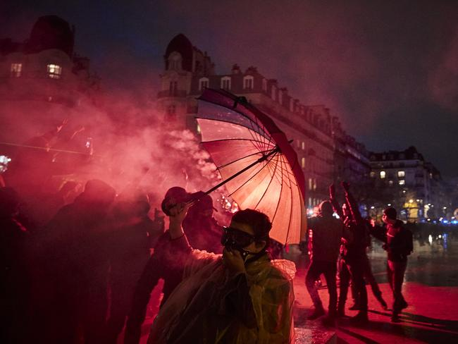 Demonstrators walk through clouds of tear gas in Paris. Picture: Kiran Ridley/Getty Images