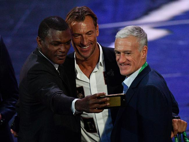 (L-R) Former French international Marcel Desailly, Morocco's national football team coach from France Herve Renard, and France's national football team coach Didier Deschamps