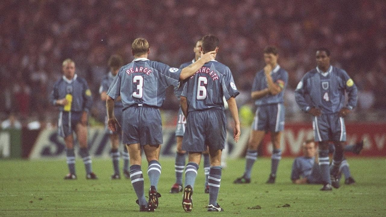 Stuart Pearce (L) consoles teammate Gareth Southgate after his penalty miss during the semi final of the European Championships against Germany in 1996.