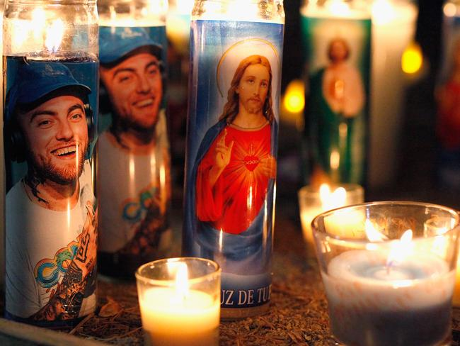 Candles form a memorial to late rapper Mac Miller in Los Angeles, California. Picture: Getty.