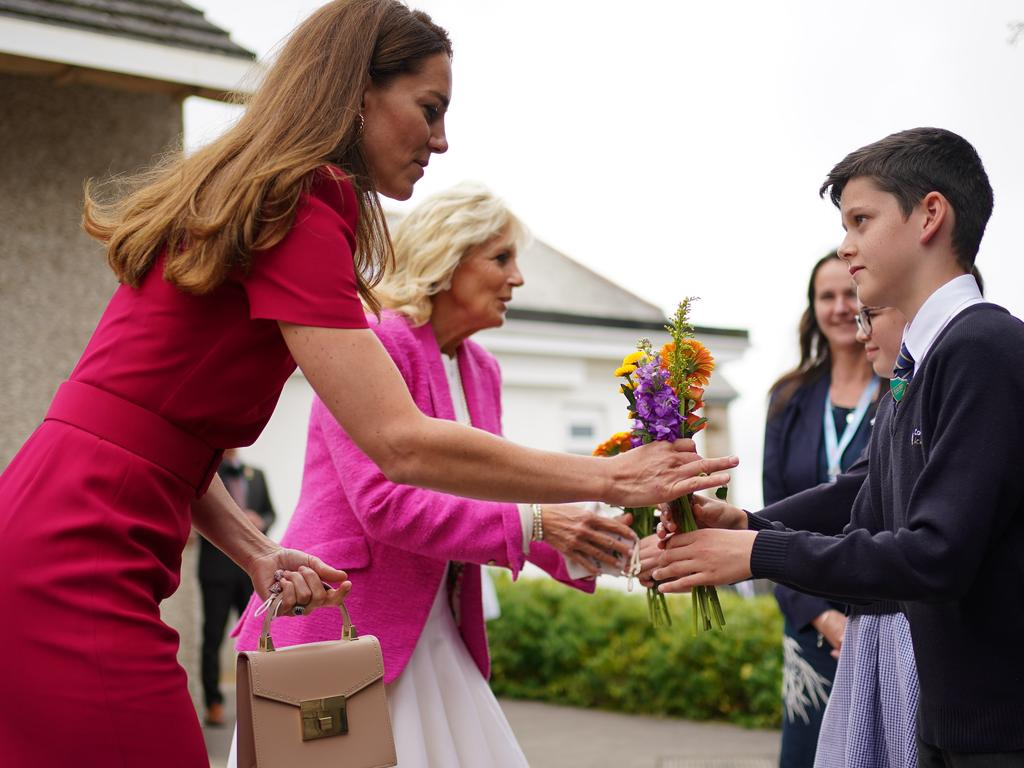 Catherine, Duchess of Cambridge and US First Lady Dr Jill Biden presented with flowers by the head boy and head girl during a visit to Connor Downs Academy, during the G7 summit in Cornwall.