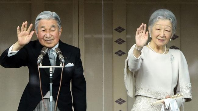 Japan's Emperor Akihito and Empress Michiko waving from the balcony of the Imperial Palace during their annual new year greeting in Tokyo 2015. Japan's lower house of parliament passed a bill on June 2, 2017 that allows ageing Emperor Akihito to step down. Picture: AFP / Toshifumi Kitamura