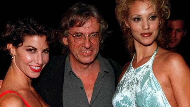 Film director Paul Verhoeven (centre) with Showgirls stars Gina Gershon (L) and Elizabeth Berkley at the film premiere in September, 1995.
