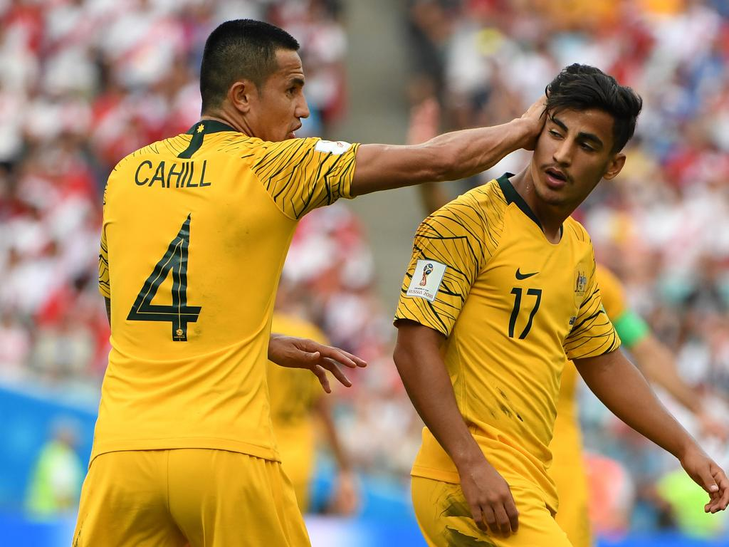 Australia's Tim Cahill and Daniel Arzani during their final FIFA World Cup group match against Peru at Fisht Stadium during the FIFA 2018 World Cup in Sochi, Russia, Tuesday, June 26, 2018. (AAP Image/Dean Lewins) NO ARCHIVING