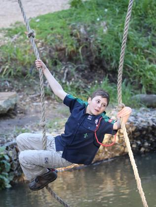 Scout Rohan Harding attempts a creek rope crossing at Woodhouse Activity Centre.