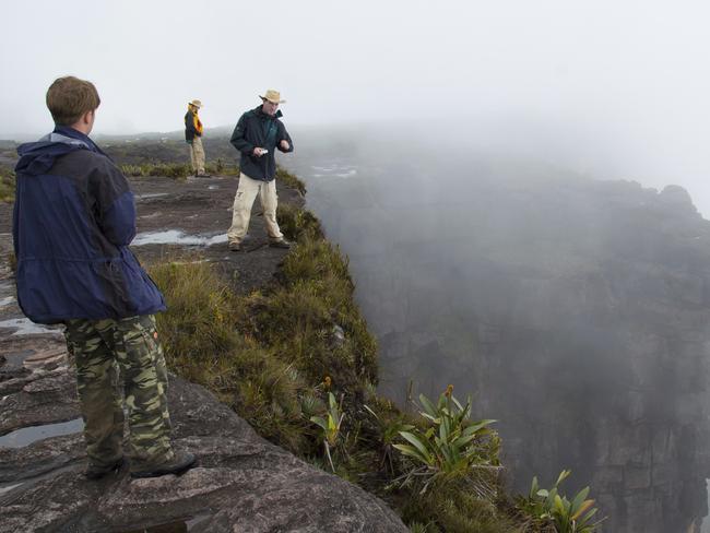 Tourists look down at Mt. Roraima.