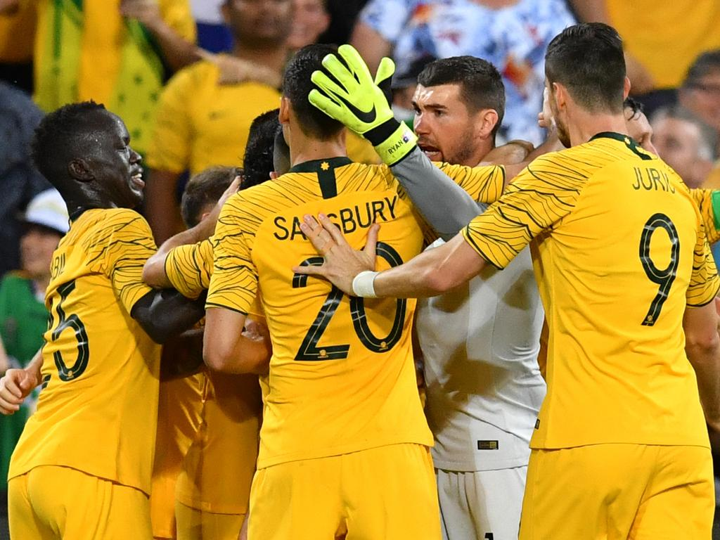 Massimo Luongo of the Socceroos celebrates scoring a goal with teammates during the International friendly match between Australia and the Korea Republic at Suncorp Stadium, in Brisbane, Saturday, November 17, 2018. (AAP Image/Darren England) NO ARCHIVING, EDITORIAL USE ONLY
