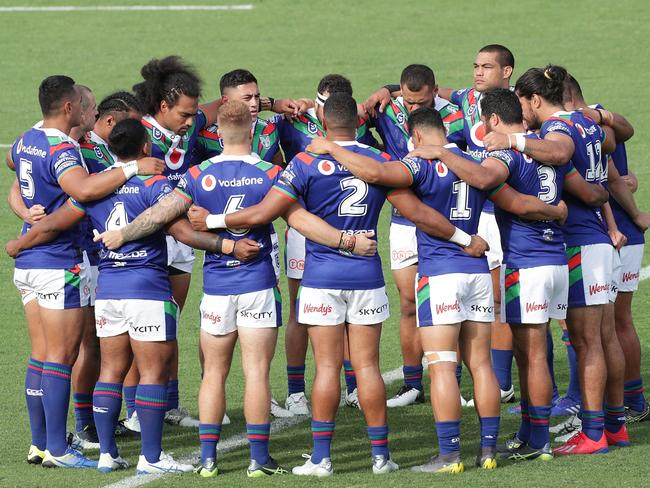 The Warriors in a huddle in reflection of the Christchurch attack.
