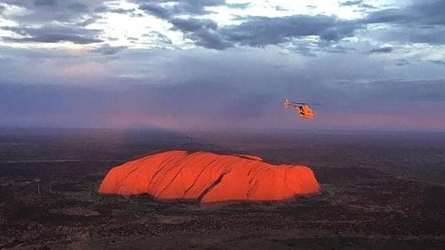 It's possible to fly over Uluru even if you're not an astronaut.