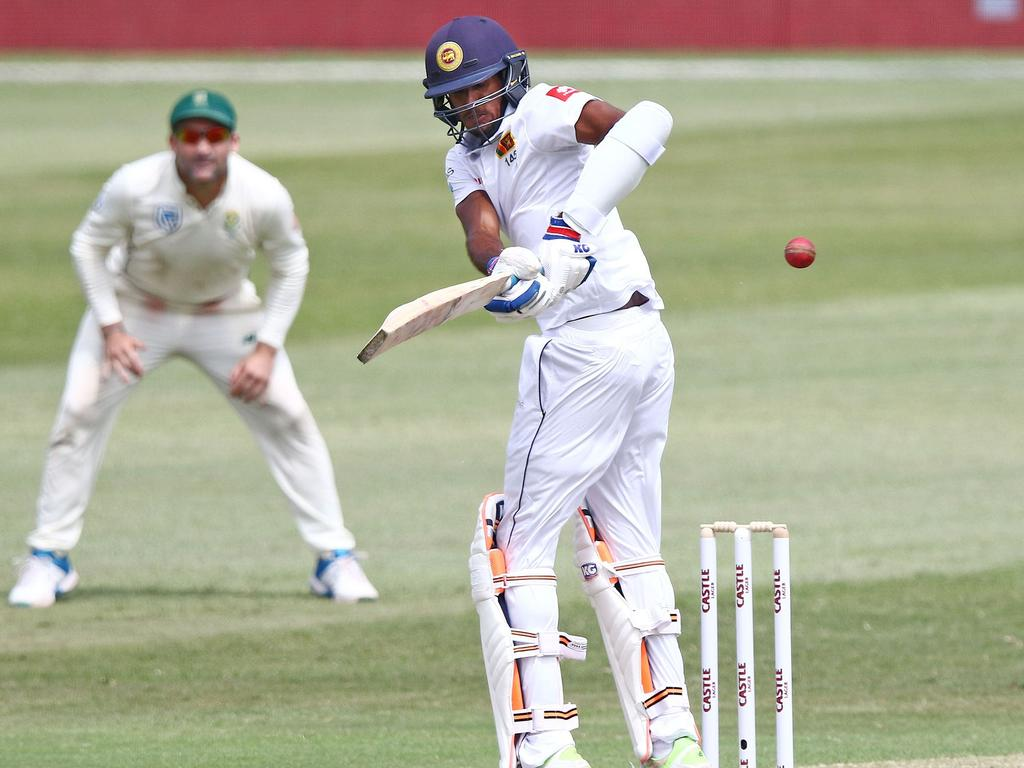 Sri Lanka's batsman Vishwa Fernando hits the ball during the day 2 of the first test match between South Africa and Sri Lanka held at the Kingsmead Stadium in Durban, on February 14, 2019. (Photo by Anesh DEBIKY / AFP)