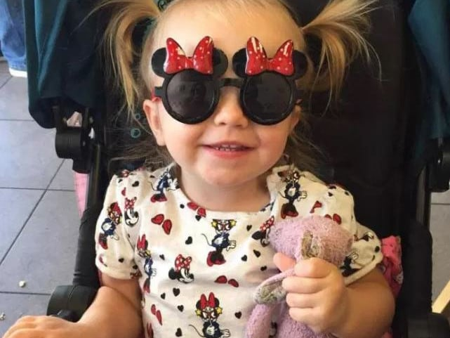 Little Amelia had to spend her second birthday on a delayed flight. Picture: Lee Sullivan