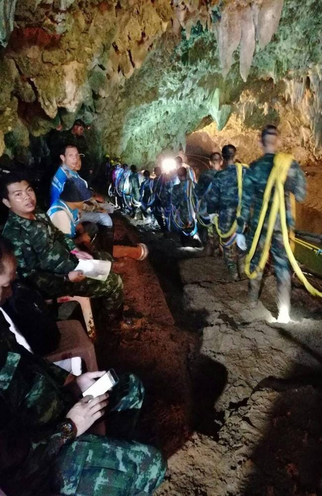 Thai soldiers enter the caves where a youth soccer team and their coach went missing more than a week ago. Picture: AFP