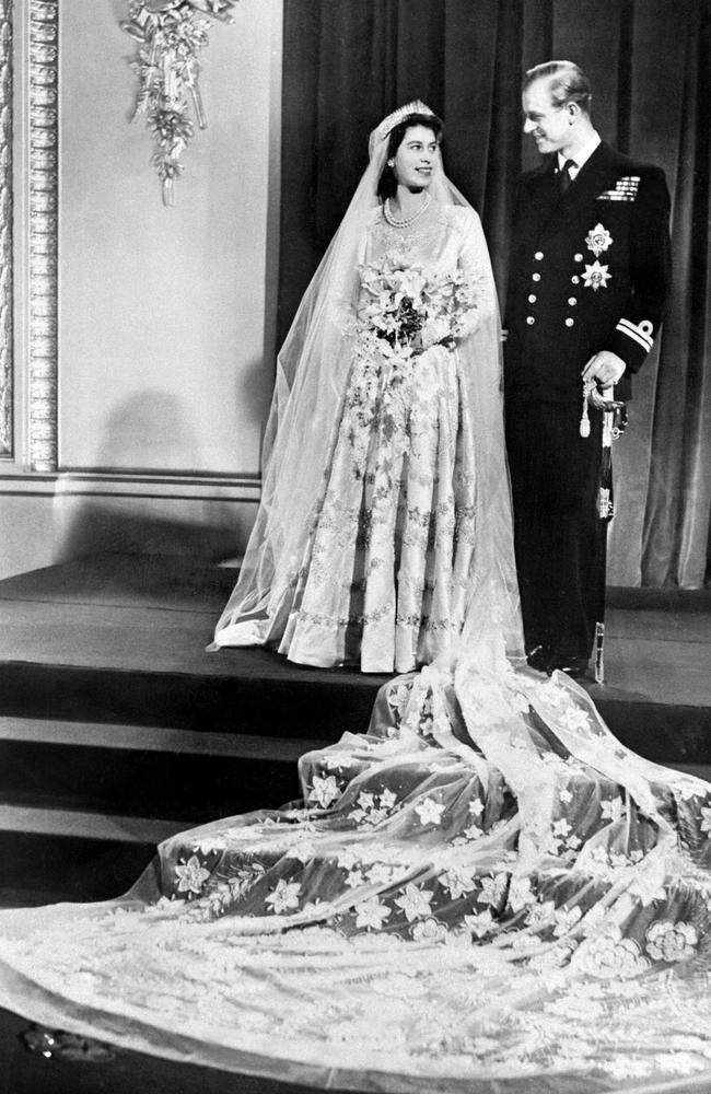 The couple on their wedding day in 1947. Picture: AFP PHOTO / STR