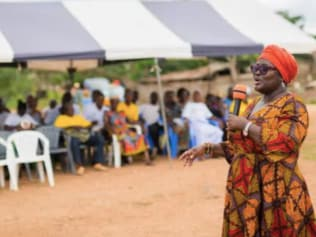Yaa Peprah-Amekudzi, the lead manager of Cadbury parent Mondelez's Cocoa Life program in Ghana, talks to villagers from a cocoa growing community. Picture: Kwabena Agyeman / KwaMani Photography.Source:Supplied