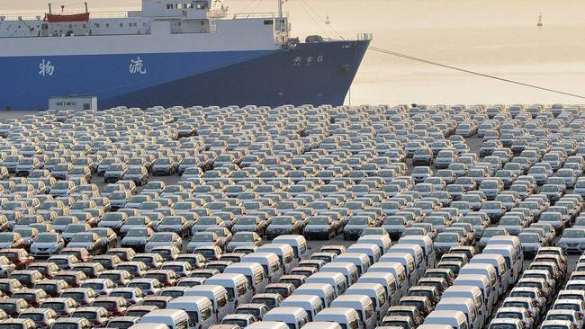 Chinese cars wait for export at a port in Dalian, Liaoning province.