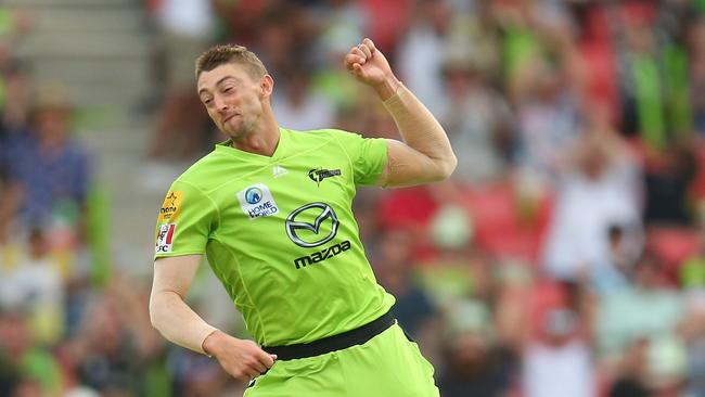 Daniel Sams jumps for joy after snaring a wicket for Sydney Thunder.