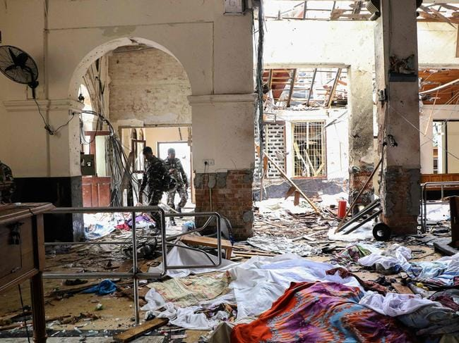 Sri Lankan security personnel walk through the blast debris at St. Anthony's Shrine following an explosion in the church in Kochchikade in Colombo on April 21, 2019. Picture: Ishara Kodikara/AFP