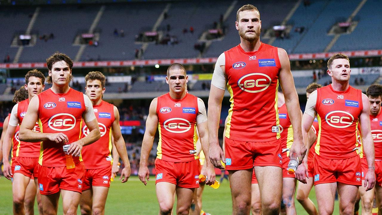 Jarrod Witts leads the Suns off after a loss to Melbourne. Photo: Michael Dodge/Getty Images