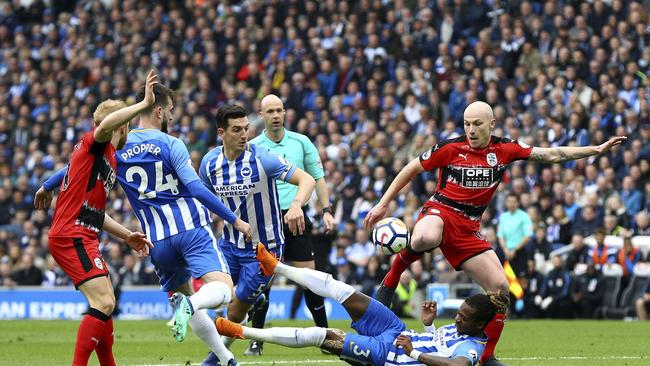 Huddersfield Town's Aaron Mooy shoots under pressure