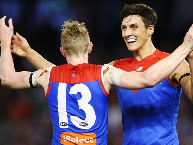 Sam Weideman celebrates with Clayton Oliver. (Photo by Michael Dodge/Getty Images)