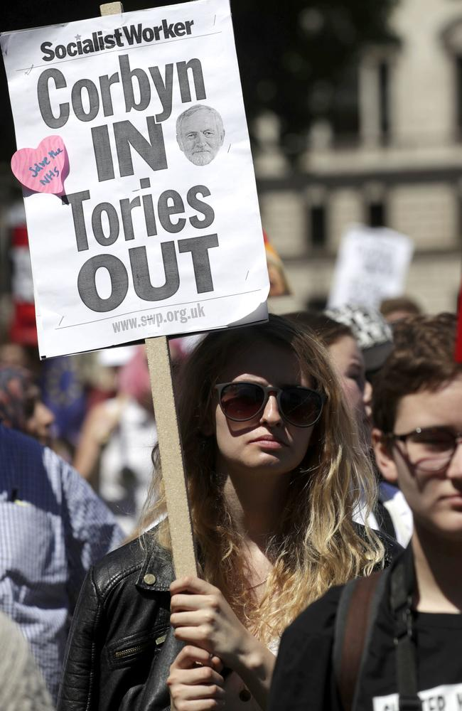 People demonstrate in Parliament Square against the possible Conservative and DUP (Democratic Unionist Party) coalition government following the Britain's general election result. Picture: Tim Ireland/AP