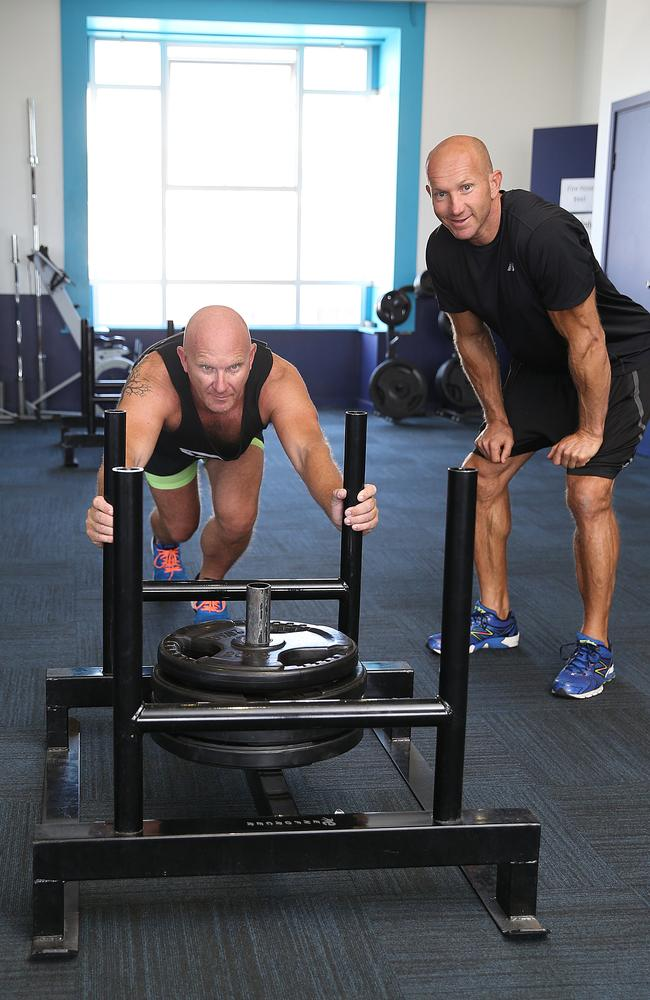 SundayFit columnist Adam MacDougall putting chef Matt Moran through a gym session. Picture: Danny Aarons