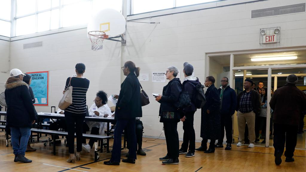 People in line to get their ballot to vote in the Michigan primary election at Chrysler Elementary School in Detroit, Michigan, on March 10, 2020. Picture: Kowalsky / AFP.