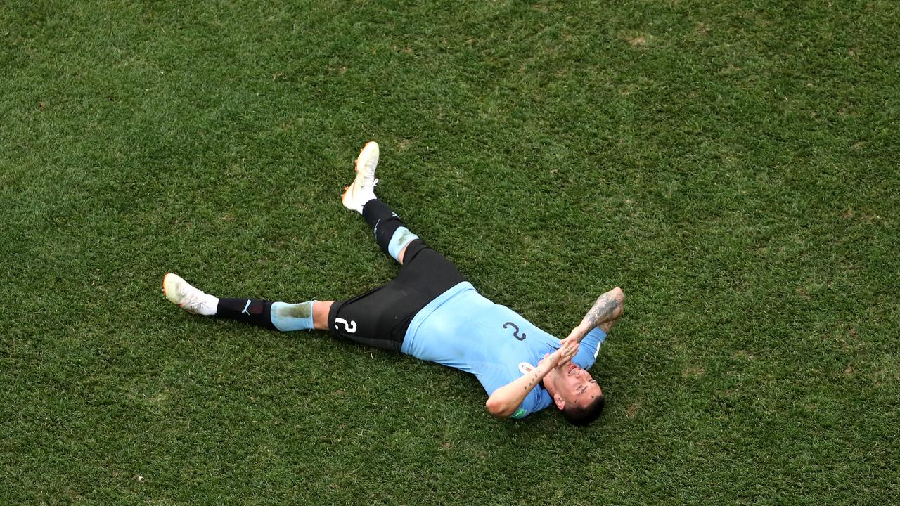 Jose Gimenez of Uruguay looks dejected following his sides defeat.