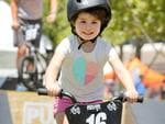 People enjoying the Santos Festival of Cycling in Victoria Square, Adelaide. Charlotte, 3, of Goodwood. (AAP IMAGE/Dean Martin)