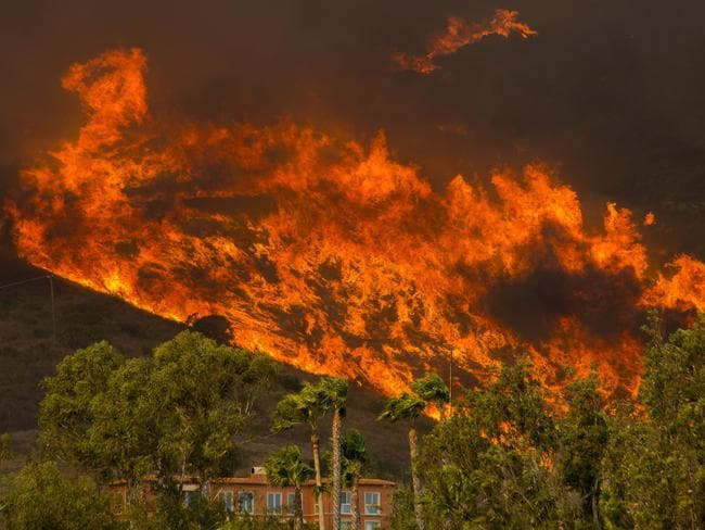 The fire approaches a home in Malibu. Picture: David McNew.