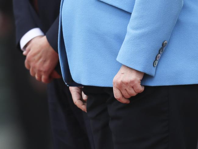 The hands of German Chancellor Angela Merkel, right, and Finland's Antti Rinne as they listen to the national anthems at the chancellery in Berlin. Picture: AP /Markus Schreiber