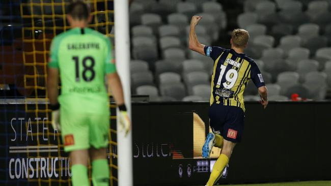 Matt Simon peels away after his matchwinning penalty. (AAP Image/Darren Pateman)