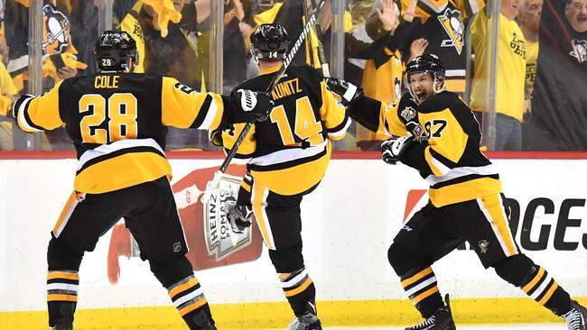 Chris Kunitz #14 of the Pittsburgh Penguins celebrates with Sidney Crosby #87 and Ian Cole #28 after scoring a goal against Craig Anderson #41 of the Ottawa Senators.