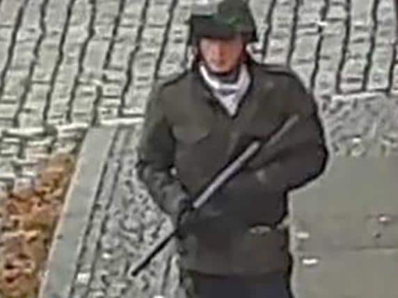 In this screenshot taken from a video by ATV-Studio Halle, a man walks with a gun in the streets of Halle an der Saale, eastern Germany, on October 9, 2019. Picture: Andreas Splett / ATV-Studio Halle / AFP